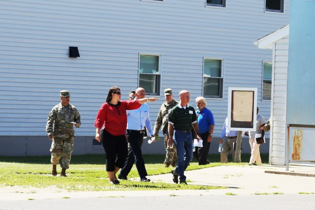 Members of the Fort McCoy workforce and a Mobilization Force Generation Installation Mobilization Assessment Team (MAT) walk through buildings in the 2700 block July 27, 2017, at Fort McCoy, Wis. The MAT comprises representatives from First Army, Army Forces Command, Installation Management Command (IMCOM), IMCOM-Readiness, the office of the Assistant Chief of Staff for Installation Management, Army Medical Command, and Army Sustainment Command. The team visited the installation for three days to assess the installation's ability to serve as a mobilization site for Army forces in the future. The most recent mobilization mission at the post ended in 2011. (U.S. Army Photo by Scott T. Sturkol, Public Affairs Office, Fort McCoy, Wis.)