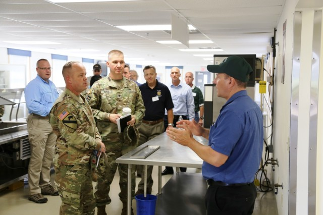 Fort McCoy Food Service Manager Andy Pisney with the Logistics Readiness Center's (LRC) Supply and Services Division addresses members of the Fort McCoy workforce and a Mobilization Force Generation Installation Mobilization Assessment Team (MAT) about installation dining facilities during a MAT visit July 27, 2017, at Fort McCoy, Wis. The MAT comprises representatives from First Army, Army Forces Command, Installation Management Command (IMCOM), IMCOM-Readiness, the office of the Assistant Chief of Staff for Installation Management, Army Medical Command, and Army Sustainment Command. The team visited the installation for three days to assess the installation's ability to serve as a mobilization site for Army forces in the future. The most recent mobilization mission at the post ended in 2011. (U.S. Army Photo by Scott T. Sturkol, Public Affairs Office, Fort McCoy, Wis.)