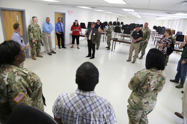 Brad Stewart, director of the Directorate of Plans, Training, Mobilization and Security, addresses members of the Fort McCoy workforce and a Mobilization Force Generation Installation Mobilization Assessment Team (MAT) about Fort McCoy facilities during a MAT visit on July 27, 2017, at Fort McCoy, Wis. The MAT comprises representatives from First Army, Army Forces Command, Installation Management Command (IMCOM), IMCOM-Readiness, the office of the Assistant Chief of Staff for Installation Management, Army Medical Command, and Army Sustainment Command. The team visited the installation for three days to assess the installation's ability to serve as a mobilization site for Army forces in the future. The most recent mobilization mission at the post ended in 2011. (U.S. Army Photo by Scott T. Sturkol, Public Affairs Office, Fort McCoy, Wis.)