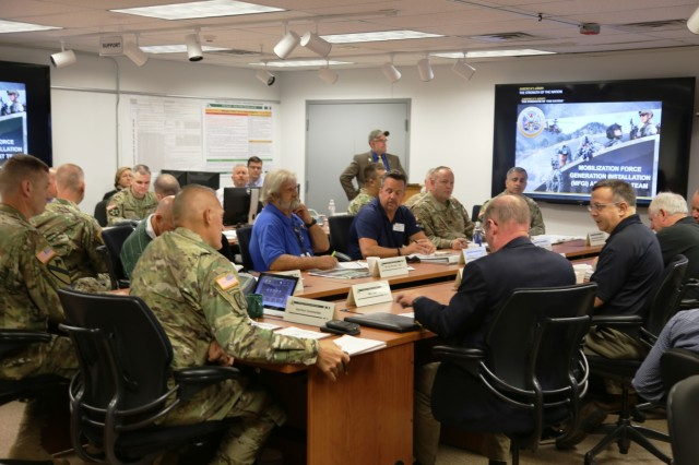 Members of the Fort McCoy workforce and a Mobilization Force Generation Installation Mobilization Assessment Team (MAT) participate in a briefing July 27, 2017, at Fort McCoy, Wis. The MAT comprises representatives from First Army, Army Forces Command, Installation Management Command (IMCOM), IMCOM-Readiness, the office of the Assistant Chief of Staff for Installation Management, Army Medical Command, and Army Sustainment Command. The team visited the installation for three days to assess the installation's ability to serve as a mobilization site for Army forces in the future. The most recent mobilization mission at the post ended in 2011. (U.S. Army Photo by Scott T. Sturkol, Public Affairs Office, Fort McCoy, Wis.)
