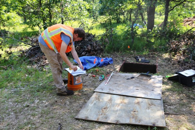 A member of the archaeology team with Colorado State University's Center for Environmental Management of Military Lands under contract with Fort McCoy works at an active phase III archaeological dig July 6, 2017, on South Post at Fort McCoy, Wis. This work is the first phase III archaeological dig at the installation. Team members found many types artifacts, such as pottery, dating back thousands of years. (U.S. Army Photo by Scott T. Sturkol, Public Affairs Office, Fort McCoy, Wis.)