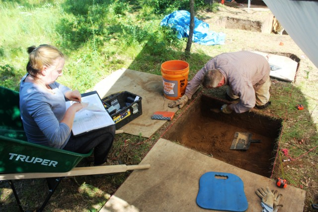 Members of the archaeology team with Colorado State University's Center for Environmental Management of Military Lands under contract with Fort McCoy work at an active phase III archaeological dig July 6, 2017, on South Post at Fort McCoy, Wis. This work is the first phase III archaeological dig at the installation. Team members found many types of artifacts, such as pottery, dating back thousands of years. (U.S. Army Photo by Scott T. Sturkol, Public Affairs Office, Fort McCoy, Wis.)