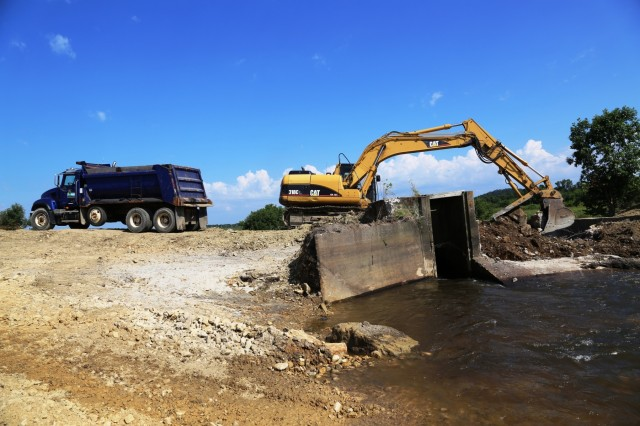 A crew with the Wisconsin Department of Natural Resources works to remove an old dam along Silver Creek on July 18, 2017, at Fort McCoy, Wis. The removal of the old dam, built in 1952, is aimed at improving stream flow and habitat. The project is coordinated between the Wisconsin Department of Natural Resources and the Fort McCoy Directorate of Public Works Environmental Division Natural Resources Branch. (U.S. Army Photo by Scott T. Sturkol, Public Affairs Office, Fort McCoy, Wis.)