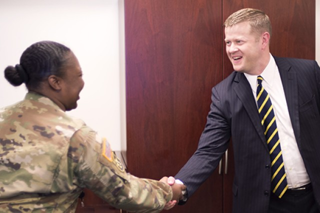 Sgt. Sheanta Scott, U.S. Army Training and Doctrine Command, left, greets Acting Secretary of the Army Ryan McCarthy, right, during a visit to Joint Base Langley-Eustis, Va., Aug. 10, 2017.