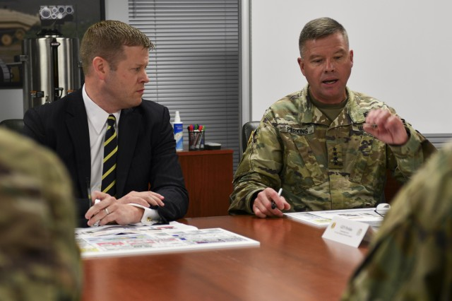 U.S. Army Gen. David G. Perkins, commander of Training and Doctrine Command, briefs Acting Secretary of the Army Ryan McCarthy, left, during a visit to Joint Base Langley-Eustis, Va., Aug. 10, 2017. During his brief, Perkins discussed TRADOC and the Army Capabilities Integration Center's role in building the future Army.