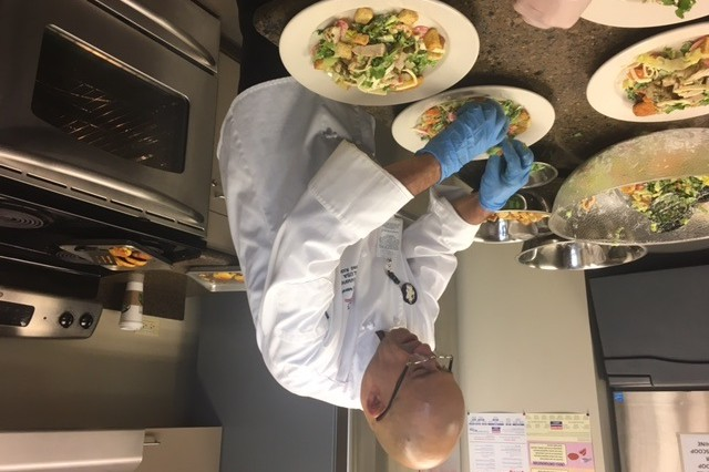 Master Sgt. Carlos Hernandez, Enlisted Aide to Army South Commander, Maj. Gen. Clarence K.K. Chinn, prepares a meal at Fort Sam Houston, Texas, March 7, 2017.