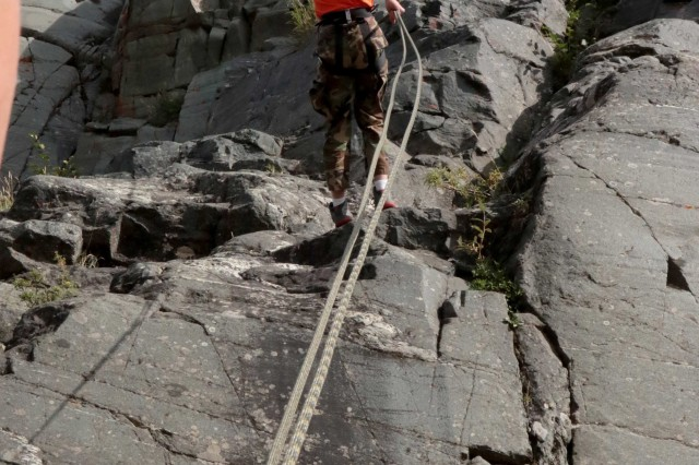 Gabriel Rockwell, a cadet with Ben Eielson High School's Junior Reserve Officer Training Corps, rappels down a cliff face at U.S. Army Alaska's Northern Warfare Training Center during the program's Summer Leadership Camp. The mountaineering familiarization course was just one day of an eight-day camp.