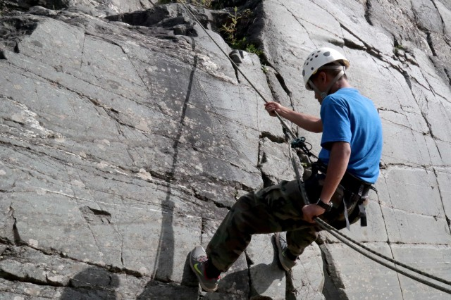 C.J. Leon Guerrero, a cadet with Ben Eielson High School's Junior Reserve Officer Training Corps, rappels down a cliff face at U.S. Army Alaska's Northern Warfare Training Center during the program's Summer Leadership Camp. The mountaineering familiarization course was just one day of an eight-day camp.
