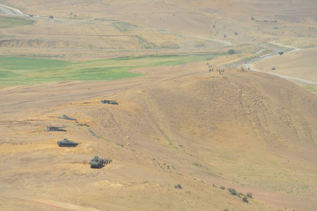 VAZIANI TRAINING AREA, Georgia - Strykers, T-72s and BMPs are in position to engage targets during a combined arms live-fire at Vaziani Training Area, Georgia, Aug. 12, 2017. The live fire displays coordination between different assets and is a demonstration of combined capability. The live fire is the last training event before the closing of Exercise Noble Partner. Exercise Noble Partner is a multinational, U.S. Army Europe-led exercise conducting home station training for the Georgian light infantry company designated for the NATO Response Force. (U.S. Army photo by Sgt. Shiloh Capers)