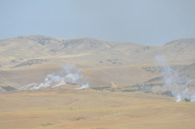 VAZIANI TRAINING AREA, Georgia - Strykers, T-72s and BMPs engage targets during a combined arms live-fire at Vaziani Training Area, Georgia, Aug. 12, 2017. The live fire displays coordination between different assets and is a demonstration of combined capability. The live fire is the last training event before the closing of Exercise Noble Partner. Exercise Noble Partner is a multinational, U.S. Army Europe-led exercise conducting home station training for the Georgian light infantry company designated for the NATO Response Force. (U.S. Army photo by Sgt. Shiloh Capers)