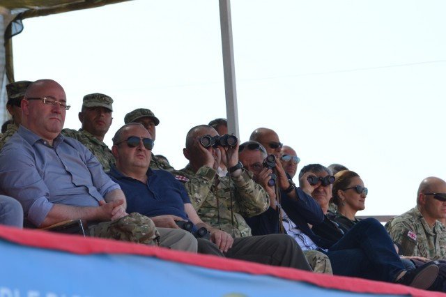 VAZIANI TRAINING AREA, Georgia - Giorgi Margvelashvili, President of Georgia, and Levan Izoaria, Minister of Defense of Georgia, attend a combined arms live-fire at Vaziani Training Area, Georgia, Aug. 12, 2017. The live fire displays coordination between different assets and is a demonstration of combined capability. The live fire is the last training event before the closing of Exercise Noble Partner. Exercise Noble Partner is a multinational, U.S. Army Europe-led exercise conducting home station training for the Georgian light infantry company designated for the NATO Response Force. (U.S. Army photo by Sgt. Shiloh Capers)