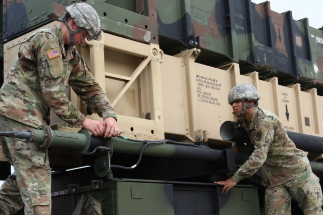 Soldiers assigned to Battery D, 6th Battalion, 52nd Air Defense Artillery Regiment assemble an antenna in order to test communication links during a battalion-wide validation exercise Aug. 3 at Osan Air Base, South Korea. The 35th Air Defense Artillery Brigade just completed the largest Patriot modernization project ever conducted outside a U.S. depot facility.
