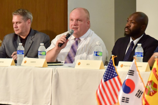 James Adamski, Direct of Directorate of Plans, Training, Mobilization and Security, gives a brief about garrison antiterrorism measures during Yongsan Townhall, Aug. 3, at the South Post Chapel.