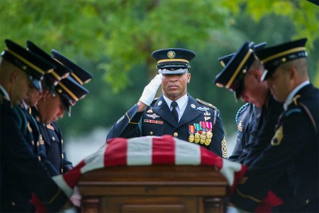 Members of the 3rd U.S. Infantry Regiment (The Old Guard), participate in the graveside service for U.S. Army Sgt. Willie Rowe at Arlington National Cemetery, Arlington, Va., Aug. 8, 2017. Rowe was missing in action, Nov. 25, 1950, after an offensive to push North Koreans to the Yala River in the Ch'ongch'on River region. He was identified by the Joint POW/MIA Accounting Command Central Identification laboratory in May 2005. Rowe's remains were repatriated in Section 60 with full military honors.