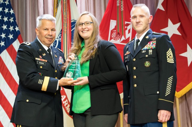 Lt. Gen. Todd Semonite, the 54th Chief of Engineers and Commanding General of USACE, and Command Sgt Maj. Bradley Houston, the 13th Command Sgt. Maj. of USACE, present the 2017 Sustainability Hero Award to Jennifer Rameriz, USACE Japan District, at the National Awards Ceremony in Washington, D.C., Aug. 1, 2017.
