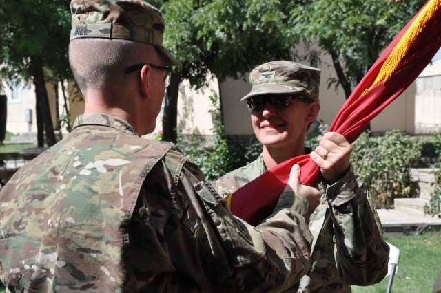Col. Kimberly Colloton (right) receives the Army Colors from Brig. Gen. David Hill, U.S. Army Corps of Engineers, Transatlantic Division commander, in a change of command ceremony, Aug. 12 at Bagram Airfield, Afghanistan. Colloton became the first female commander of the Transatlantic Afghanistan District sine the district's establishment in 2013.