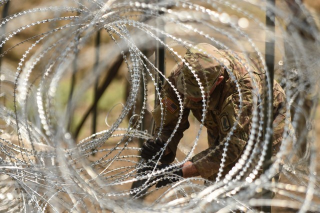 Engineers from 54th Brigade Engineer Battalion prep a concertina wire obstacle for training during Exercise Noble Partner 17. Noble Partner 17 (NP17) is a European Rotational Force (ERF) exercise that builds Georgia's light infantry company's contribution to the NATO Response Force (NRF).