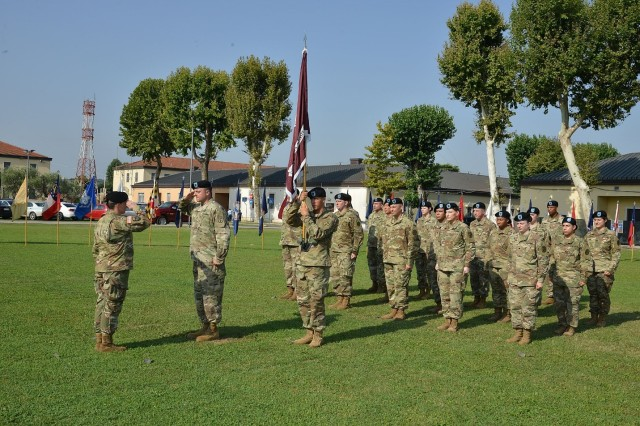 1st Sgt. Danny Hailey salutes Lt. Col. Sarah Goldman as she takes charge of Public Health Activity-Italy during the change of command ceremony Aug. 2 at Caserma Ederle, Italy.