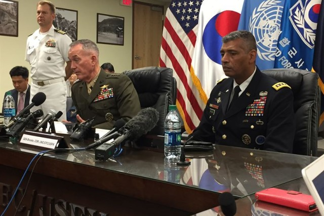 Marine Corps Gen. Joe Dunford, chairman of the Joint Chiefs of Staff, and Army Gen. Vincent K. Brooks, the U.S. Forces Korea commander, answer media questions during a news briefing at Combined Forces Command in Seoul, South Korea, Aug. 14, 2017.