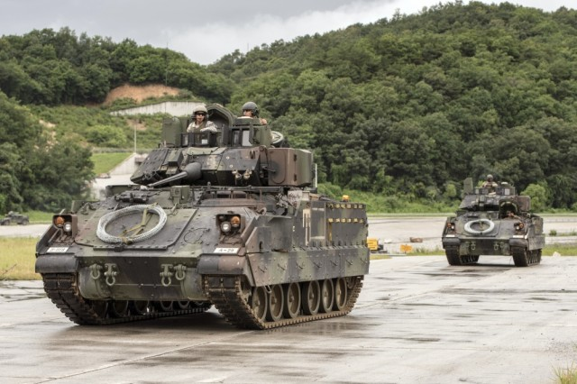 Bradley Fighting Vehicles from Alpha Company, 8th Brigade Engineer Battalion return after conducting breaching operations during an exercise in Korea Aug. 10, 2017.