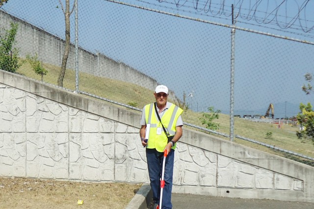 US Army Corps of Engineers Buffalo District engineer Robert Simmington measures a lot as part of a facility condition assessment on a federal property in South Korea in June 2017.