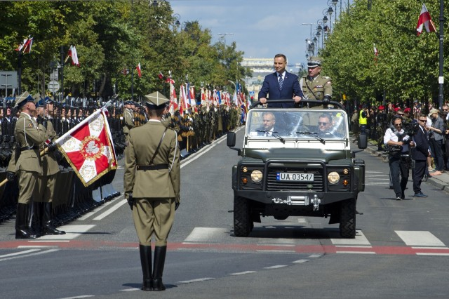 President of the Republic of Poland, Andrzej Duda arrived at the 97th anniversary of the Battle of Warsaw Aug. 15, 2017, in Warsaw, Poland in a personal motorcade. This national holiday in Poland, known as the Feast of the Polish Armed Forces, included Soldiers from Canada, Estonia, Romania, United States and the United Kingdom. As part of the unified Alliance, the NATO Soldiers and their collective combat vehicles participated in the annual Polish parade to celebrate that historic victory and honor active duty services members, veterans and fallen Soldiers