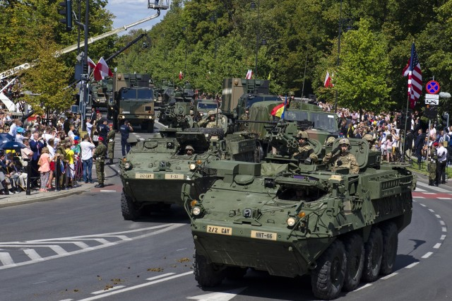 U.S. Strykers with the 2nd Squadron, 2nd Cavalry Regiment drove passed the parade tower during the 97th anniversary of the Battle of Warsaw Aug. 15, 2017, in Warsaw, Poland. This national holiday in Poland, known as the Feast of the Polish Armed Forces, included Soldiers from Canada, Estonia, Romania, United States and the United Kingdom. As part of the unified Alliance, the NATO Soldiers and their collective combat vehicles participated in the annual Polish parade to celebrate that historic victory and honor active duty services members, veterans and fallen Soldiers