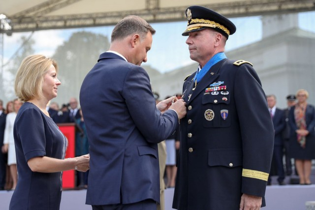 President of the Republic of Poland, Andrzej Duda presented the Commanding General of U.S. Army Europe, Lt. Gen. Ben Hodges with the Commander's Cross with the star of the Order of Merit of the Republic of Poland during 97th anniversary of the Battle of Warsaw Aug. 15, 2017, in Warsaw, Poland. This national holiday in Poland, known as the Feast of the Polish Armed Forces, included Soldiers from Canada, Estonia, Romania, United States and the United Kingdom. As part of the unified Alliance, the NATO Soldiers and their collective combat vehicles participated in the annual Polish parade to celebrate that historic victory and honor active duty services members, veterans and fallen Soldiers. (Courtesy Photo by Krzysztof Sitkowski)