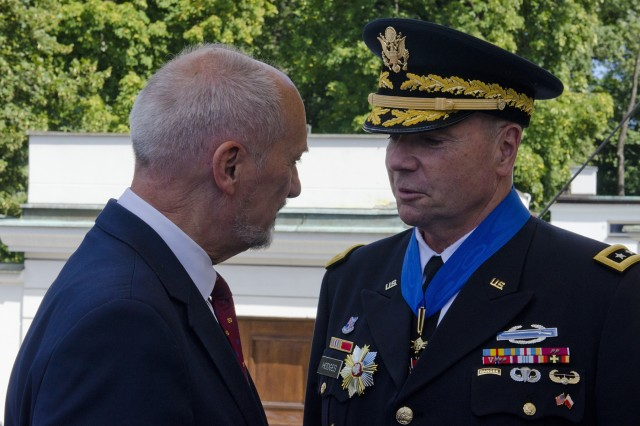 Minister of National Defense, Antoni Macierewicz thanked the Commanding General of U.S. Army Europe, Lt. Gen. Ben Hodges for his service during the 97th anniversary of the Battle of Warsaw Aug. 15, 2017, in Warsaw, Poland. This national holiday in Poland, known as the Feast of the Polish Armed Forces, included soldiers from Canada, Estonia, Romania, United States and the United Kingdom. As part of the unified Alliance, the NATO Soldiers and their collective combat vehicles participated in the annual Polish parade to celebrate that historic victory and honor active duty services members, veterans and fallen Soldiers.