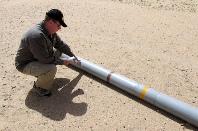 Thomas Little, an end-use monitoring program manager, confirms the serial number on a damaged missile before its disposal.