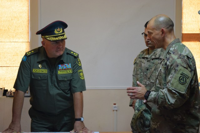 Col. Jose Devarona, director of U.S. Army Central Security Cooperation Division, right, provides an overview of Exercise Steppe Eagle 17 and an exercise control group update to Lt. Gen. Murat Maikeyev, chief of the general staff of the Kazakhstan Armed Forces, July 31, 2017, at Illisky Training Center near Almaty, Kazakhstan.