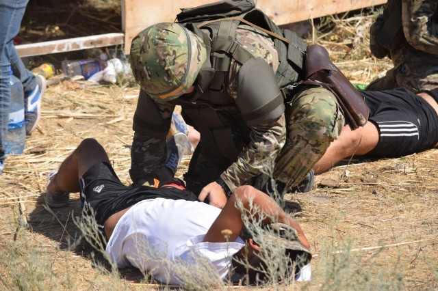 A Kazakhstani soldier with the Kazakhstan Peacekeeping Battalion performs tactical first aid on a simulated leg wound Aug. 1, 2017, during Exercise Steppe Eagle 17 at Illisky Training Center near Almaty, Kazakhstan.