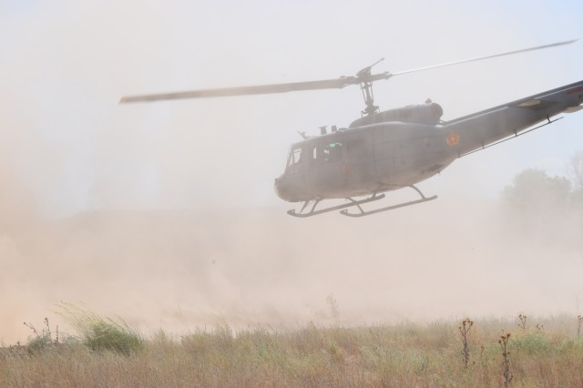 A Bell Utility Helicopter 1 Iroquois lifts off after picking up casualties during a simulated medical evacuation mission Aug. 1, 2017, for Exercise Steppe Eagle 17 at Illisky Training Center near Almaty, Kazakhstan.