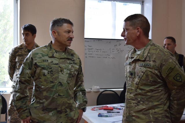 Brig. Gen. Jeffrey Van, Task Force Spartan deputy commanding general, left, discusses the U.S. Army participation in Exercise Steppe Eagle 17 with Lt. Col. Kent Cavallini, 149th Military Engagement Team deputy commander, Aug. 3, 2017, during the distinguished visitor's day at Illisky Training Center near Almaty, Kazakhstan. Exercise Steppe Eagle is a premier multinational exercise focused on peacekeeping and peace support operations, while building relationships and mutual understanding between partner nations.
