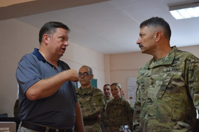 John Cornelius, an exercise planner with U.S. Army Central, left, discusses the Exercise Control Group operations with Brig. Gen. Jeffrey Van, Task Force Spartan deputy commanding general, Aug. 3, 2017, during the distinguished visitor's day of Exercise Steppe Eagle 17 at Illisky Training Center near Almaty, Kazakhstan. Exercise Steppe Eagle is a premier multinational exercise focused on peacekeeping and peace support operations, while building relationships and mutual understanding between partner nations.