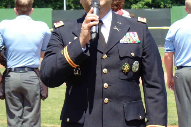 """Army Maj. Edgar Quinones-Marin sings the national anthem during pregame festivities July 10, 2017, at Potomac Nationals Stadium in Woodbridge, Virginia. """"The biggest compliment I can get is when people tell me they get 'goose bumps' when I sing - because they know what the song means, and they are feeling what I'm feeling when I sing it,"""" he said."""