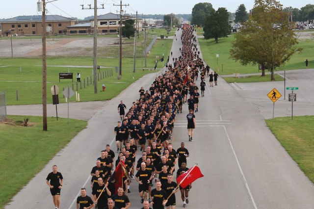 "Maj. Gen. Andrew Poppas, commander, 101st Airborne Division and Fort Campbell, leads Soldiers, from throughout the division, during a division run on Fort Campbell, 16 August, 2017. The run was the beginning of a series of events scheduled, in celebration of the division's 75th Anniversary of ""Legacy of Heroism,"" to take place from 16 - 26 Aug. (Photo By: Staff Sgt. Todd Pouliot, 40th Public Affairs Detachment)"