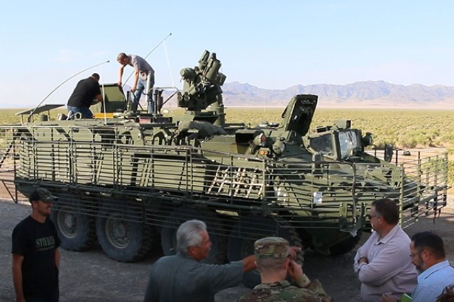 Observers watch as technicians prepare the Army's Stryker Nuclear, Biological, Chemical, Reconnaissance Vehicle for Joint Chemical Agent Detector system Stryker-On-The-Move tests at Target S Grid at Dugway Proving Ground, July 2017. The JCAD will be integrated with the Stryker vehicle as a replacement for the Automatic Chemical Agent Detection Alarm, which will no longer be manufactured for and fielded by the Army. Photo captured from video by Darrell L. Gray, Dugway Proving Ground Public Affairs.