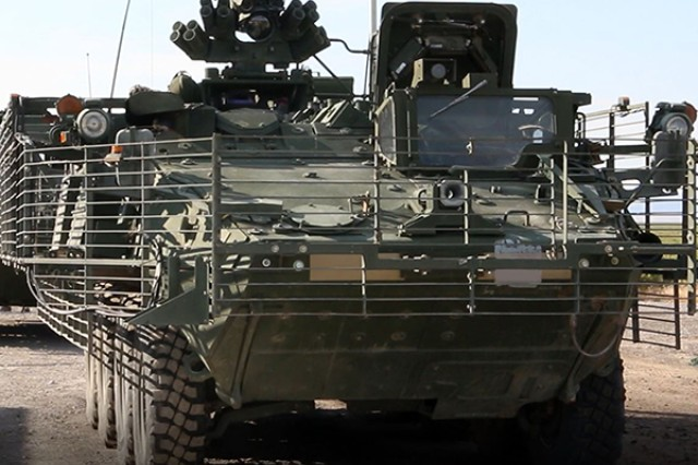 The Army's Stryker Nuclear, Biological, Chemical, Reconnaissance Vehicle awaits the start of the Joint Chemical Agent Detector system Stryker-On-The-Move test at Target S Grid at Dugway Proving Ground, July 2017. The JCAD will be integrated with the Stryker vehicle as a replacement for the Automatic Chemical Agent Detection Alarm, which will no longer be manufactured for and fielded by the Army. Photo captured from video by Darrell L. Gray, Dugway Proving Ground Public Affairs.