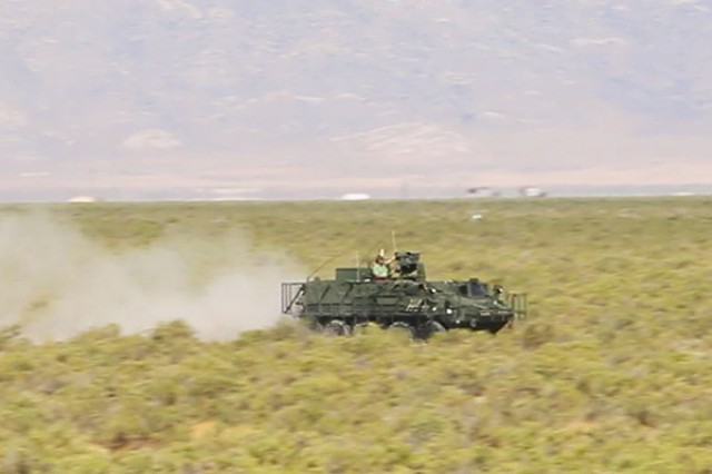 An instrumented Stryker Nuclear, Biological, Chemical, Reconnaissance Vehicle speeds down the grid trail during Joint Chemical Agent Detector system Stryker On-The-Move tests at Target S Grid at Dugway Proving Ground, July 2017. Dugway's data gathering capabilities, large area, and technical expertise made it the perfect location for the system tests. Photo captured from video by Darrell L. Gray, Dugway Proving Ground Public Affairs.