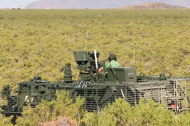 Operators on an instrumented Stryker Nuclear, Biological, Chemical, Reconnaissance Vehicle await instructions from test officers on a grid trail during Joint Chemical Agent Detector system Stryker-On-The-Move tests at Target S Grid at Dugway Proving Ground, July 2017. Dugway's data gathering capabilities, large area, and technical expertise made it the perfect location for the system tests. Photo captured from video by Darrell L. Gray, Dugway Proving Ground Public Affairs.
