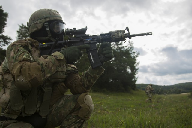 Georgian soldiers of the 31st Infantry Battalion provide security while conducting react to contact scenarios during a mission rehearsal exercise (MRE) at the Joint Multinational Readiness Center in Hohenfels, Germany, Aug. 9, 2017. The MRE is a U.S. Marine Corps lead exercise involving nearly 900 Soldiers from Georgia, Hungary and the U.S. The MRE is based on the current operational environment and incorporates lessons learned in order to prepare the 31st Inf. Bn. (Georgian) for offensive and defensive operations, and a deployment in support of Operation Freedom Sentinel. (U.S. Army photo by Pfc. Zachery Perkins)