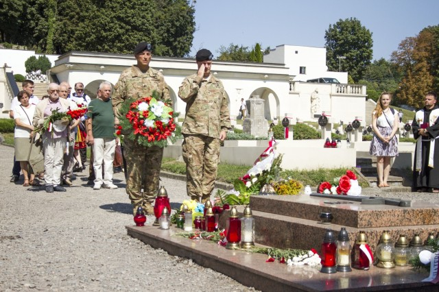 Col. Charles Booze, chief of staff of the 45th Infantry Brigade Combat Team and Joint Multinational Training Group-Ukraine, and Command Sgt. Maj. Walter Jolly, senior enlisted Soldier of the 1st Battalion, 279th Infantry Regiment, 45th IBCT, lay a wreath at a Polish memorial honoring Polish soldiers who were killed while serving during the Polish-Soviet War between 1919 and 1921, in Lviv, Ukraine on Polish Armed Forces Day, Aug. 15.Both the Polish and the 45th IBCT are in Ukraine with the Joint Multinational Training Group-Ukraine, an international coalition dedicated to improving the Yavoriv Combat Training Center on the International Peacekeeping and Security Center in Western Ukraine. (Photo by Sgt. Anthony Jones, 45th Infantry Brigade Combat Team)