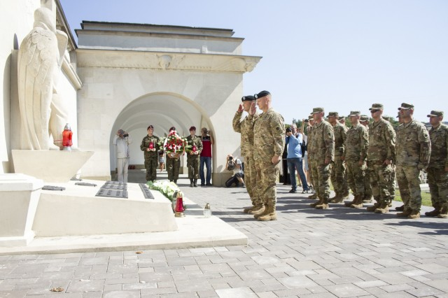 Col. Charles Booze, chief of staff of the 45th Infantry Brigade Combat Team and Joint Multinational Training Group-Ukraine, and Command Sgt. Maj. Walter Jolly, senior enlisted Soldier of the 1st Battalion, 279th Infantry Regiment, 45th IBCT, lay a wreath at a Polish memorial honoring American volunteer pilots who were killed while serving with the Polish military during the Polish-Soviet War between 1919 and 1921, in Lviv, Ukraine on Polish Armed Forces Day, Aug. 15.Both the Polish and the 45th IBCT are in Ukraine with the Joint Multinational Training Group-Ukraine, an international coalition dedicated to improving the Yavoriv Combat Training Center on the International Peacekeeping and Security Center in Western Ukraine. (Photo by Sgt. Anthony Jones, 45th Infantry Brigade Combat Team)
