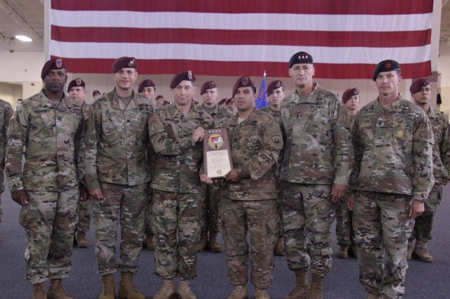Chief Warrant Officer 2 William G. Gallerani (center left), battalion maintenance officer of 3rd Battalion, 160th Special Operations Aviation Regiment and Sgt. 1st Class Alan Kielor (center right), noncommissioned officer in charge of 3-160th SOAR maintenance pose for a photo with their command team after receiving the 2016 Army Award for Maintenance Excellence (AAME) at Hunter Army Airfield Aug. 14, 2017. The AAME program is conducted each year to recognize Army units that have demonstrated excellence in maintenance operations. During the ceremony, Soldiers of 3-160th maintenance team were recognized for their hard work that led to the unit receiving the award. (U.S. Army photo by Staff Sgt. Nikki Felton/ released)