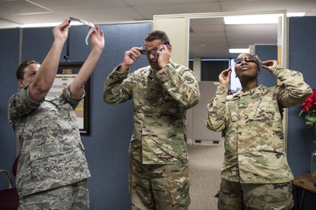 Members of the South Carolina National Guard test their solar eclipse safety glasses Aug. 9, 2017, in Columbia, South Carolina. The glasses were distributed by the South Carolina National Guard Safety Office in preparation for the solar eclipse that will occur Aug. 21, 2017.