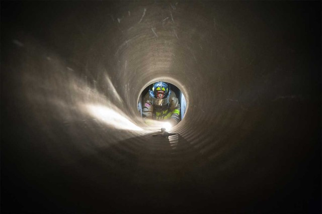 A Soldier assigned to the 336th Firefighter Detachment, navigates a confined space during Combat Support Training Exercise, at Fort McCoy, Wis., Aug. 9, 2017. More than 12,000 service members from the U.S. Army, Navy, Marine Corps and six other countries trained at Fort McCoy, Wis., as part of the 84th Training Command's CSTX 86-17-02 and Army Reserve Medical Command's Global Medic; this joint and multi-national exercise was designed to ensure that America's Army Reserve units are capable, combat ready and lethal.