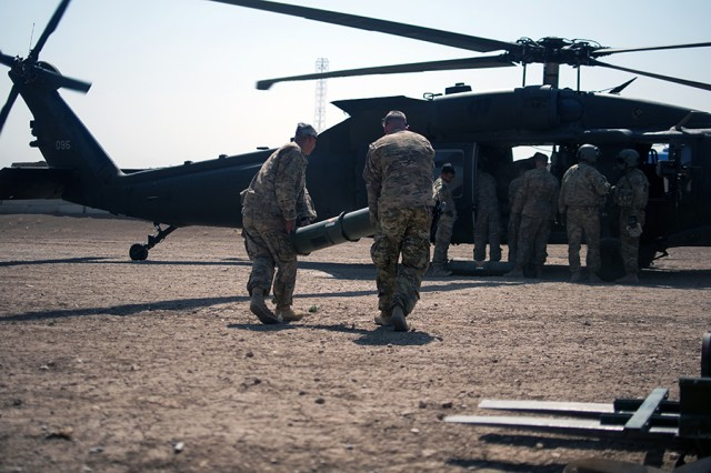 Paratroopers load munitions onto a helicopter at Forward Operating Base Shalalot, Iraq, on July 6, 2017. The ammunition needed to sustain the fight in the U.S. Central Command area of operations is provided by the 1st Theater Sustainment Command operational command post.