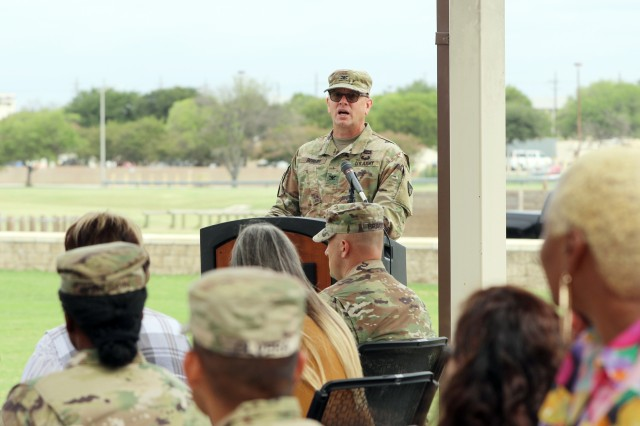 Col. William Boruff provides comments during the 901st Contracting Battalion's uncasing ceremony Aug. 16 at Hildner Field, Fort Hood, Texas. Boruff, who officiated the ceremony, is the commander of the Mission and Installation Contracting Command at Joint Base San Antonio-Fort Sam Houston, Texas.