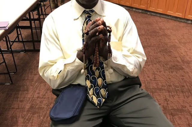 Morgan Muldach holds his prayer beads after leading a Buddhist service at Cache Creek Chapel at Fort Sill, Okla. Muldach has been a practicing Buddhist for decades and says that like many others, he had a lot of questions as he began learning about the faith.